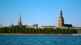 Riga cityscape wallpaper Old Town panorama with Daugava river and clear sky stock video