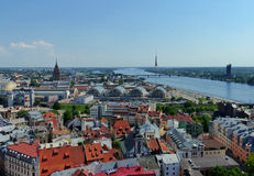 Riga panorama. View of Riga from the tower of St Peter's church, showing the River Daugava, central market halls and Soviet style Academy of Sciences building Stock Photography