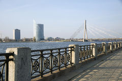 Riga. Quay of the river Dvina and a kind on the bridge. Stock Images