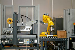 Riga robot Immagine Stock
