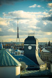 Riga rooftops, clock tower Stock Photography