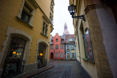 Riga's Old Town street view to the tower of the Cathedral Royalty Free Stock Photography