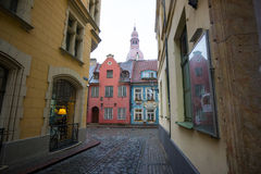 Riga's Old Town street view to the tower of the Cathedral Royalty Free Stock Photo