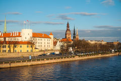 Riga skyline in the rays of the setting sun Stock Images