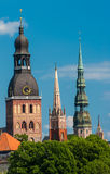 Riga. Towers of Riga seen in Riga. Three church towers in the picture are the Riga Dome cathedral,  St. Saviour's Church and St. Peter's church. On the right is Royalty Free Stock Image