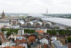 Riga view. Panoramic view over Riga with television tower on the island Zakusala, the river Daugava, market halls and the cultural palace from Stalins era Stock Photography