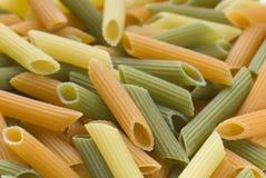 Rigati pasta. Rigati dry pasta three flavors Stock Photos