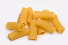 Rigatoni, Italian pasta on a white background. Rigatoni, Italian pasta lying helter-skelter on a white background Royalty Free Stock Photos