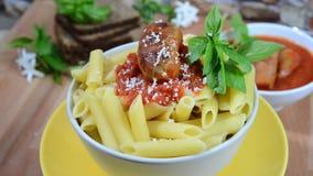 Rigatoni italian pasta with tomato sauce stock video