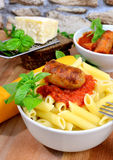 Rigatoni italian pasta with tomato sauce Royalty Free Stock Images