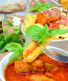 Rigatoni italian pasta with tomato sauce Royalty Free Stock Photos