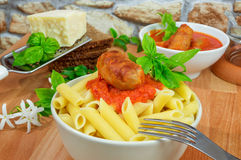 Rigatoni italian pasta with tomato sauce Stock Images