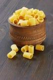 Rigatoni italian pasta in wood bowl Royalty Free Stock Image