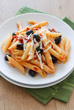 Rigatoni with Olives and Tomat Stock Photo