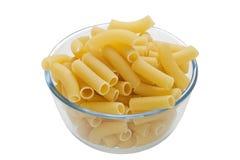 Rigatoni pasta in bowl. On white background Royalty Free Stock Photos