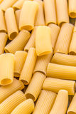 Rigatoni. Pasta close up and background. Scattered  pasta photo. Classic Italian food -  pasta royalty free stock photos