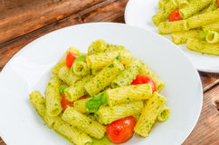 Rigatoni pasta with genoese pesto and sherry tomato Royalty Free Stock Photo