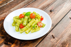 Rigatoni pasta with genoese pesto and sherry tomato Royalty Free Stock Photography