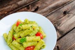 Rigatoni pasta with genoese pesto and sherry tomato Stock Photography