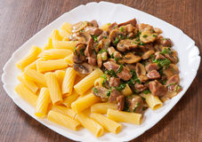Rigatoni pasta with meat and mushroom sauce Stock Image