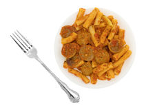 Rigatoni pasta with meatballs and sausage on plate plus fork Royalty Free Stock Photo