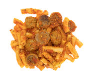 Rigatoni pasta with meatballs and sausage on a white background Stock Photos