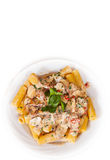 Rigatoni pasta with mushroom sauce in a plate. top view. Royalty Free Stock Photo