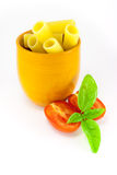 Rigatoni pasta in an orange jar Stock Photography