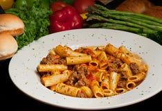 Rigatoni Pasta with Sausage. Italian Rigatoni Pasta Dish with Spicy Italian sausage Stock Photo