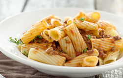 Rigatoni pasta with a tomato beef sauce Stock Photos
