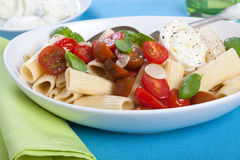 Rigatoni pasta with tomatoes and mozarella Royalty Free Stock Images