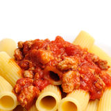 Rigatoni with Sausage-Tomato Sauce. Rigatoni with sausage and tomato sauce on white background Royalty Free Stock Photo