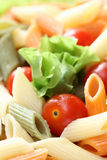Rigatoni with tomatoes and lettuce. Rigatoni (penne rigate pasta) with tomatoes and lettuce. Close-up Royalty Free Stock Photography