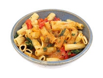 Rigatoni with vegetables with a cheese sauce in bowl Royalty Free Stock Photo