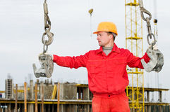 Rigger builder while slinging Royalty Free Stock Photo