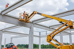 Rigger is in the cherry picker on construction site Stock Images