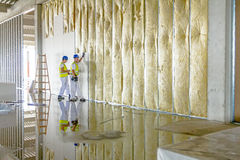 Riggers are working on thermal partition dry wall with mineral w Royalty Free Stock Photo