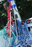 Rigging. Blocks and colour cords. Sailing rigging. Blocks and colour cords. Detail of yacht royalty free stock photo