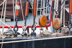 Rigging and details of marine equipment of sailboat closeup - ropes, pulley. Parts of an old ship Royalty Free Stock Photography