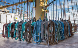 Rigging the mast of a large a tall ship stock images