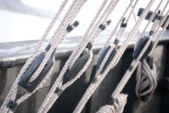 Rigging on an Old Sail Boat. Wooden blocks, pulleys and ropes on an old wooden sail boat stock images