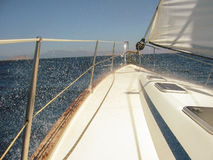 Rigging parts and spray. A small sea yacht Royalty Free Stock Photos