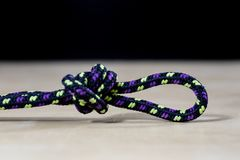 Rigging, sailing accessories. Rope block and shekel on a wooden. Table. Black background Royalty Free Stock Images