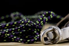 Rigging, sailing accessories. Rope block and shekel on a wooden. Table. Black background Royalty Free Stock Photos