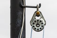 A rigging rig on a rusty metal pole. royalty free stock images