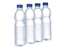 Righe delle bottiglie di acqua Immagini Stock
