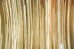 Righe dorate verticali priorità bassa Fotografie Stock