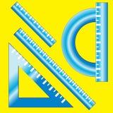 Righello e goniometro blu su giallo Fotografia Stock Libera da Diritti