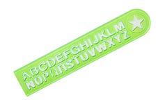 Righello verde con l'alfabeto immagine stock