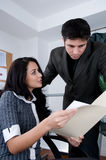 Is this right?. Female worker asking for advice on a file. Shot with Hi Res Camera Royalty Free Stock Photo